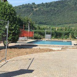 Erreci-Castellini-recinzione-entrata-sassi02